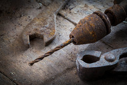 rsz_bigstock-old-rusty-tools-in-the-worksho-99255113